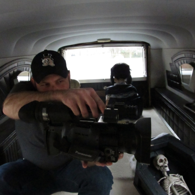 Brenton feeling oddly comfortable filming from the back of Cassandra's Hearse Mary